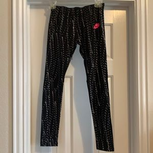 Girl's Nike black polka dot leggings, Size M